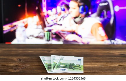Euro money on the background of a TV on which e-sports is shown, sports betting, euro money, cybersport