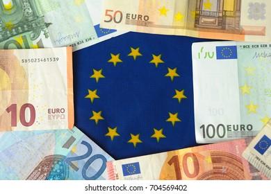 Euro money on Europe union flag