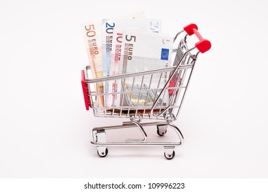 Euro notes in a trolley on a white background