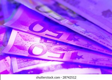 Euro notes under real uv light.