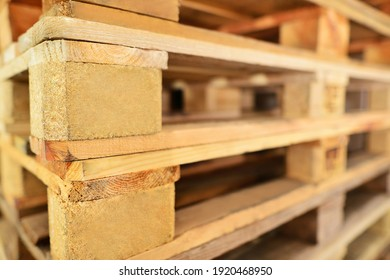 Euro pallet stack. Focus on EPAL and EURO signs. Close up of Piles of EPAL pallets.