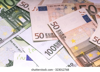 Euro paper money: closeup of banknotes, fifty, hundred, finances, investment, business, background, texture.