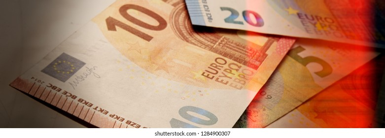 Euro paper notes are on the table. The currency of the European Union. Web banner.