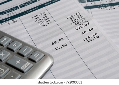 Euro Pay slip and calculator, close up for payroll or salary background, french mention Net to pay