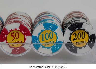 Euro poker chips on white background