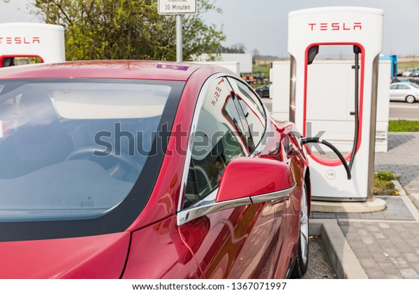 Euro Rastpark Pfaffenhofen, GERMANY - April 9, 2019 Charging TESLA cars at the charging station. Tesla Moles S 70D, Tesla supercharge station with a car on charging.