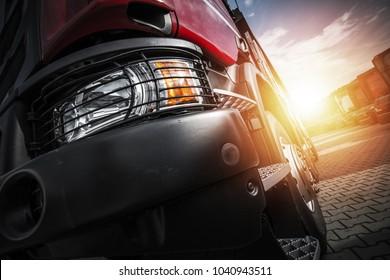 Euro Semi Truck Driving. Transportation Industry Concept Photo.