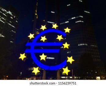 Euro sign at European Central Bank headquarters in Frankfurt, Germany illuminated at night