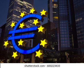 Euro sign at night Frankfurt, Germany - Euro sign in front of former ECB seat ,february 14, 2017