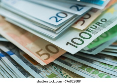 Euro and USA dollar money banknotes background, wealth concept