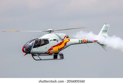 Eurocopter EC120 Colibri Helicopter of the Spanish Air Force team Patrulla Aspa performing at the Dutch Air Force Open Day on June 20, 2014 in Gilze Rijen, The Netherlands