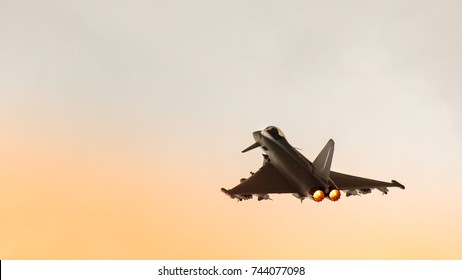 Eurofighter with afterburners at sunset