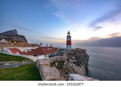 Europa Point Lighthouse and rock of Gibraltar during sunrise