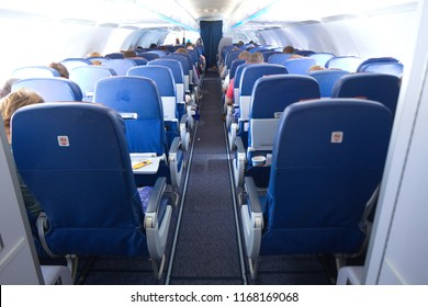 Europe, Airspace, May 2018:blue seats of the plane passengers in the interior of economy class