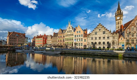 Europe Belgium medieval town travel background - panorama of Ghent canal and Graslei street on sunset. Ghent, Belgium