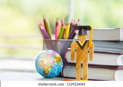Europe Education knowledge learning study abroad international Ideas. People Sign wood with Graduation celebrating cap on stack textbook with model global map, alternative studying world wide