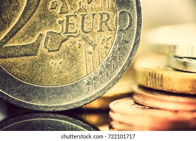 Europe fiat money or euro currency concept : Closeup view of used two euro coin with grooves and scratches. Euro is official currency of eurozone used by central bank, ECB and institutions in EU.