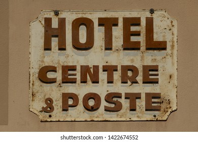 Europe, France, Hautes-Pyrénées , 06-2019,A rusty vintage enamel sign indicating a post office in the French mountain village of Cauterets,