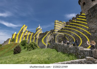 Europe France, Carcassonne,  05-2018 : , To celebrate the 20 years of its classification at UNESCO, The French town of Carcassonne covered the walls of it's medieval city with circles of yellow .