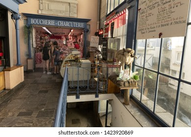 Europe, France, Cauterets, 2019-06, a store selling cold cuts, cheese, and a variety of salads, to  tourists in the central food arcade of Cautert village. A horned taxidermied high mountain sheep.