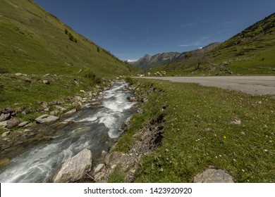 Europe, France, Pyrenees, 05-2019, Water streams from melting snow cut through a valley in the mountains of French Pyrenees, close to the Plateau of Cambasque.