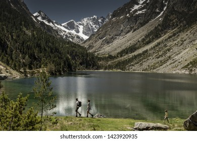 Europe, France, Pyrenees, 06-2019, Gaube Lake  is a lake in the French Pyrenees, in the department of the Hautes-Pyrénées, near the town of Cauterets. Landscape with high mountains and snow;