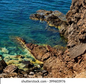 in europe greece santorini island hill and rocks on the summertime beach
