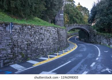 Europe, Italy, Bellagio, Lake Como, ROAD PASSING THROUGH ARCH BRIDGE