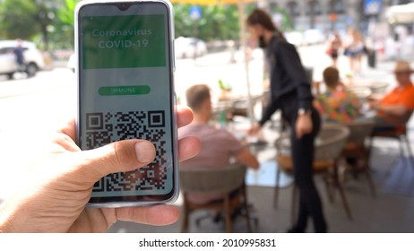 Europe, Italy ,  Milan, July 2021  Green Pass European Eu Digital Covid-19 passport Certificate to travel - tourists in downtown of the city