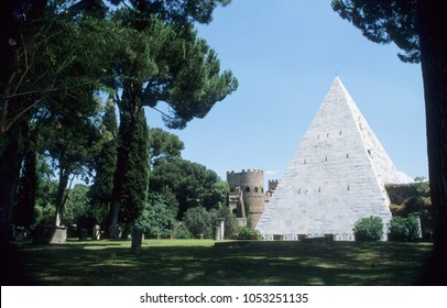 Europe Italy Rome 2001 Protestant Cemetery. Inside garden looking out towards the Roman Wall and white stone Pyramid of Cestus.