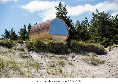 Europe, Latvia, Cape Kolka. House in the form of a barrel on the dunes for a double stay at the coast of the Baltic Sea.