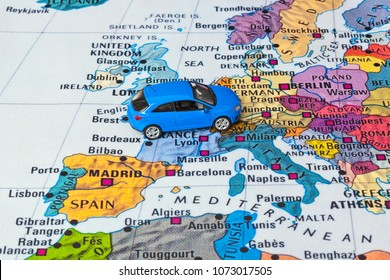 Europe map and car toy - travel background