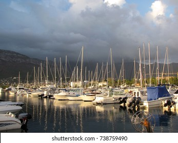 Europe. Mediterranean area. Adriatic sea. Dalmatian riviera. Moored yachts in the rays of sunlight. Marina of Bar city. Spring 2015.