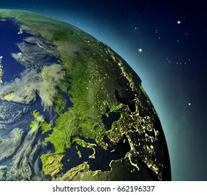 Europe on planet Earth with glowing atmosphere lit by evening sun. 3D illustration with detailed planet surface. Elements of this image furnished by NASA.