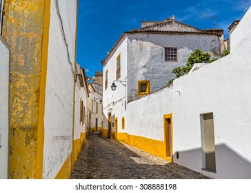 Europe, Portugal, Alentejo-street view of Evora, medieval city in the afternoon.