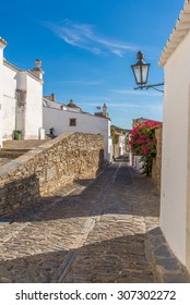 Europe, Portugal, Alentejo-street view of the medieval village in the afternoon.