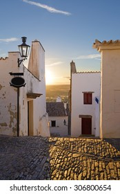 Europe, Portugal, Alentejo-View of the small village of Monsaraz at sunset - backlight effect