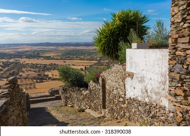 "Europe, Portugal, Evora, Monsaraz village - view from a traditional street to the fields of ""alentejo"" portuguese region"