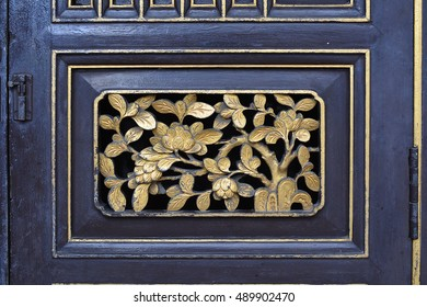 From europe to siam,the cultural mixture between chinese and portuguese be seen at architecture building in phuket old town.Wood carving door.