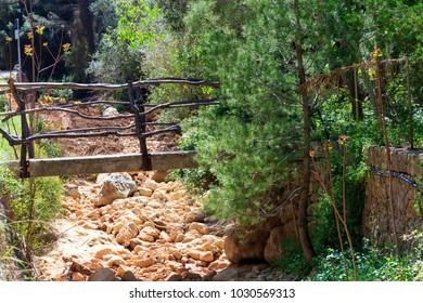 Europe, Spain, Balearic Islands, Mallorca.cala Banyalbufar. Walkers bridge over canyon.