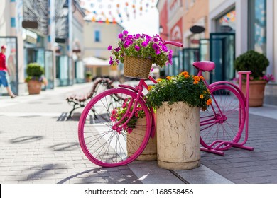 Europe street shops flowers bicycles Sunny day