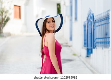 Europe summer travel destination Greece tourist woman on vacation, walking on the streets of old and beautiful villages in Greece.