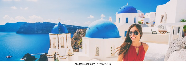 Europe summer vacation tourist woman walking in Oia city at three blue domes church, Santorini, Greece. Popular european attraction famous cruise travel. Banner panorama.