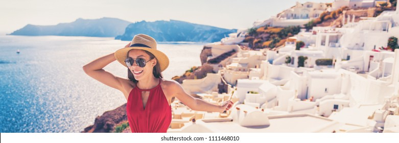 Europe travel luxury cruise vacation destination tourist woman in Santorini, Oia, Greek Islands, Greece, Europe. Girl on summer holiday having fun walking in white village. Banner panorama.