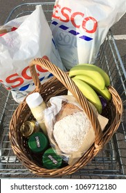 Europe UK Bedfordshire Bedford 14th April 2018. Inside major supermarket. Weekly food shopping in plastic carrier bags. Also foods in wicker basket and supermarket trolley.