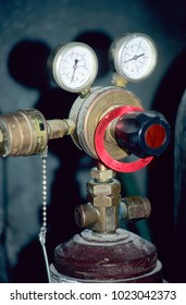 Europe UK Bedfordshire Bedford 1998. Close up of steel cylinder bottle. Two pressure dials attached to brass neck valve.