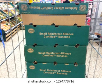 Europe UK Bedfordshire Bedford January 2019. Stacked cardboard boxes of fresh bananas inside major supermarket shopping aisle.