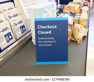 Europe UK Bedfordshire Bedford September 2018. Inside major supermarket. Customer checkout. Warning sign for checkout closed. Finance and banking information leaflets.