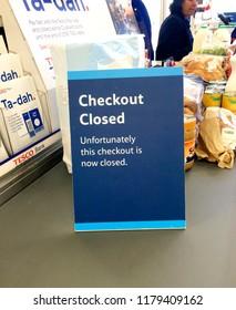 Europe UK Bedfordshire Bedford September 2018. Inside major supermarket. Customer checkout. Warning sign for checkout closed. Financial and banking information leaflets.