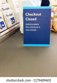Europe UK Bedfordshire Bedford September 2018. Inside major supermarket. Customer checkout. Warning sign for checkout closed. Banking and financial information leaflets.